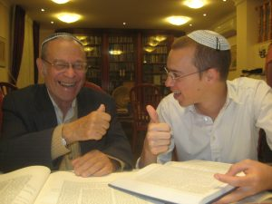Learning Talmud with his grandson, Dovi.